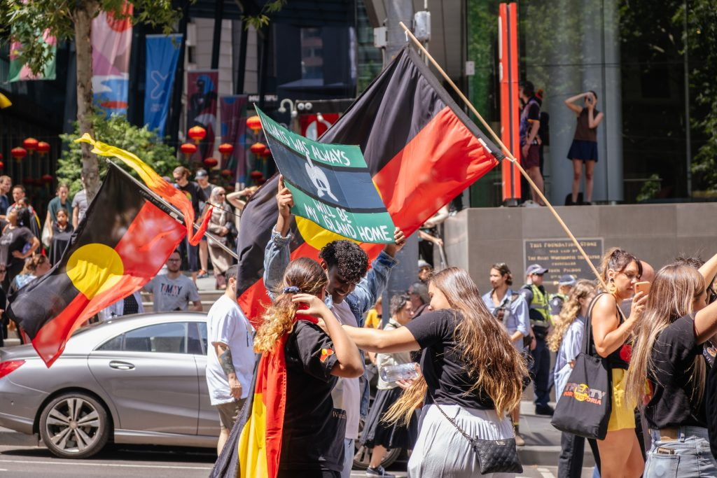 Crowded streets of protesters in an Indigenous Australian Black Lives Matter protest.