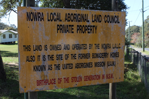 """Sign that reads: """"Nowra Local Aboriginal Land Council Private Property"""" Birthplace of the stolen generation of New South Wales."""